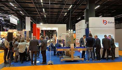 business people around large exhibition stand