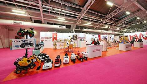 long and wide exhibition stand with toy trucks